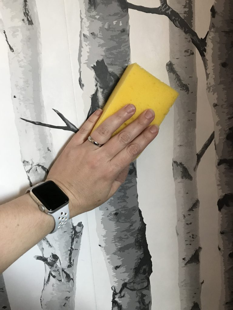Wiping off wallpaper paste